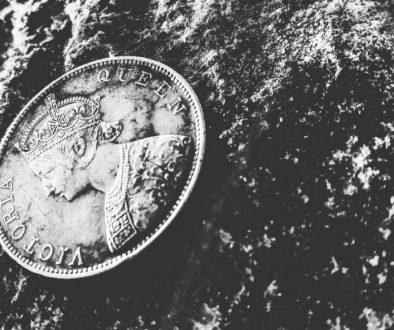 grayscale-photo-of-victoria-queen-coin-on-top-of-rock-731164 (1)